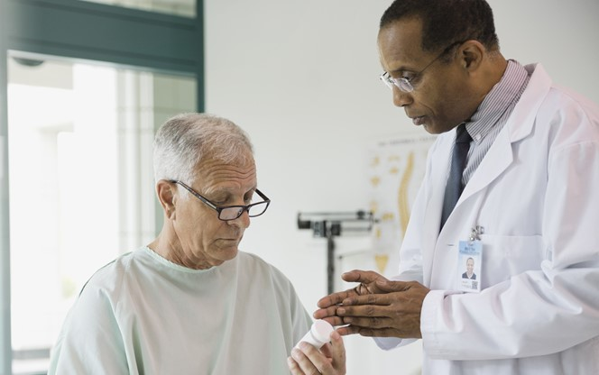 Doctor Explaining A Prescription To Patient