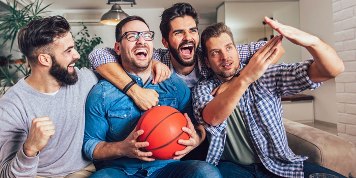 Happy Friends Or Basketball Fans Watching Basketball Game On Tv And Celebrating Victory