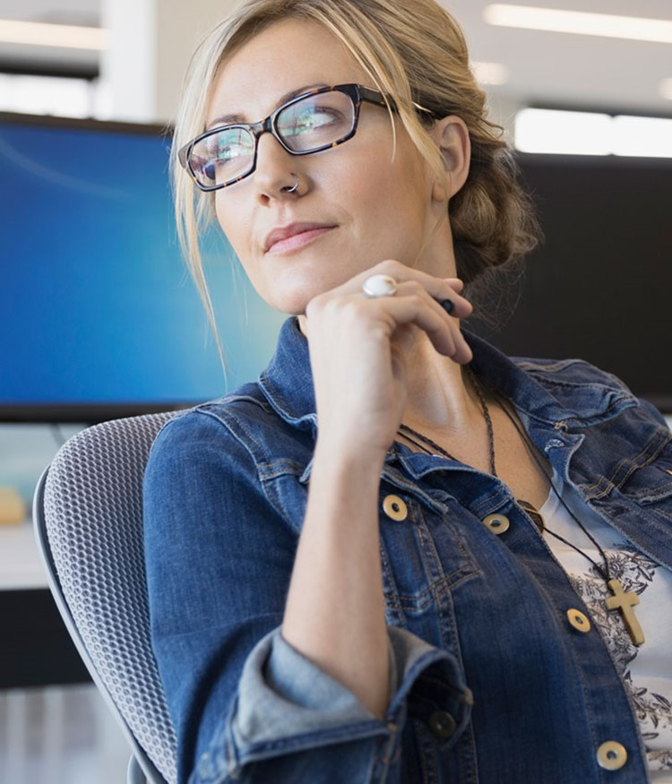 Pensive Businesswoman Looking Away In Office