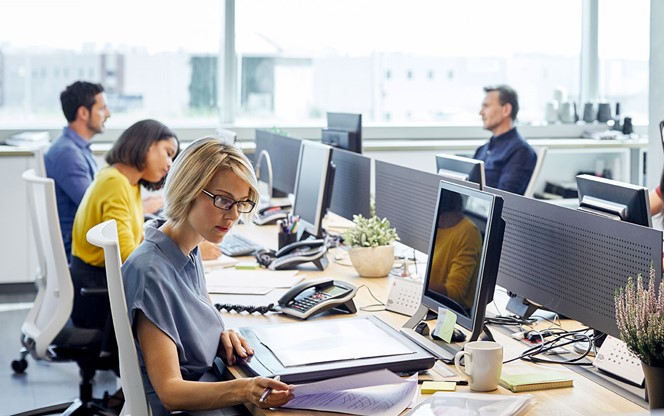 Business people working at desk by window
