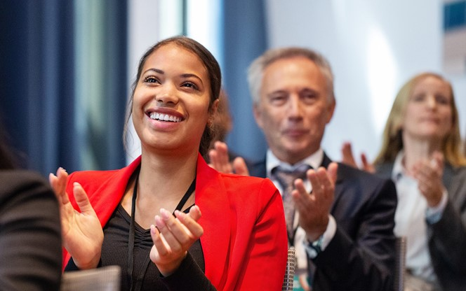 Business people applauding during launch event