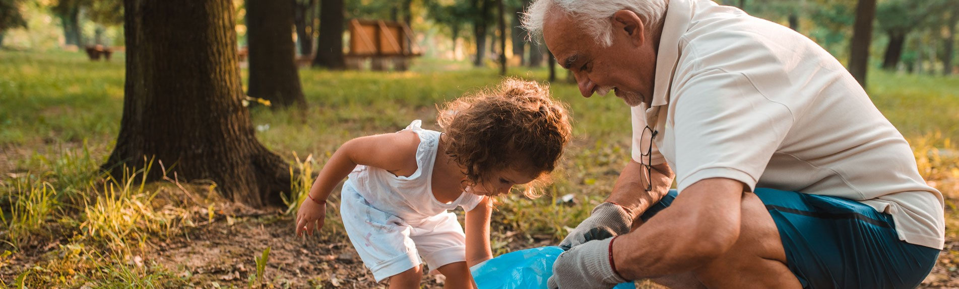 Grandpa And His Granddaughter Keeping The Environment Clean