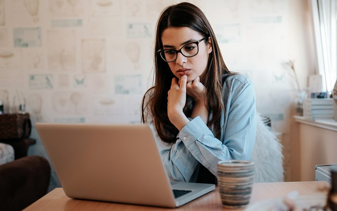 Worried Girl Looking At Laptop At Home