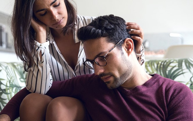 Caring Woman Comforting Depressed Man