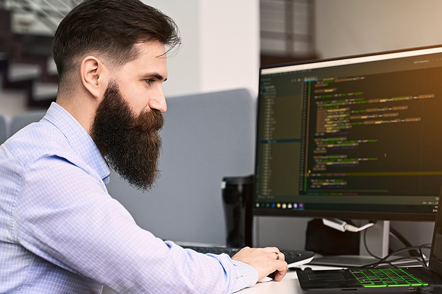 Software Programmer Man Working On Computer In IT Office Writing Code