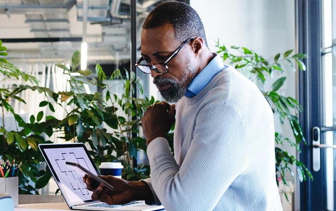 African American Man Working In Modern Office