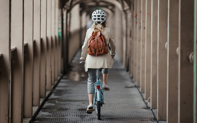 Young Lady Riding A Bike To Work
