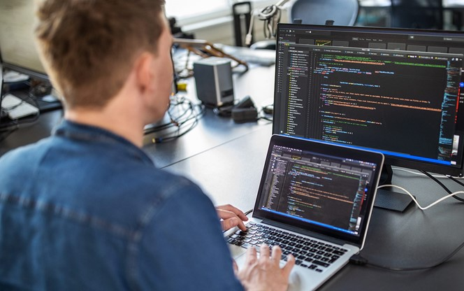Computer Programmer Working On New Software Program