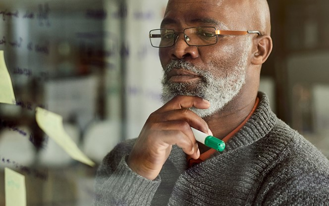 Mature Black Man Thinking And Planning