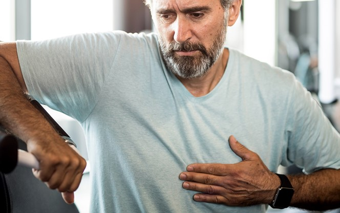 Man Feeling Chest Pain At The Gym