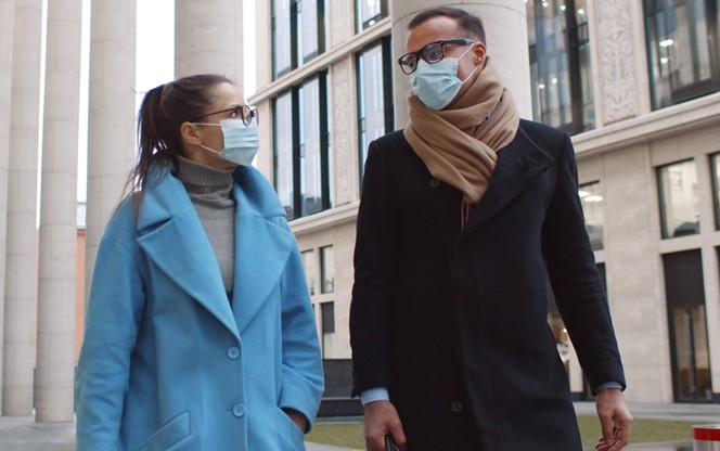 Business Colleagues Wearing Protective Masks Talking Meeting In City
