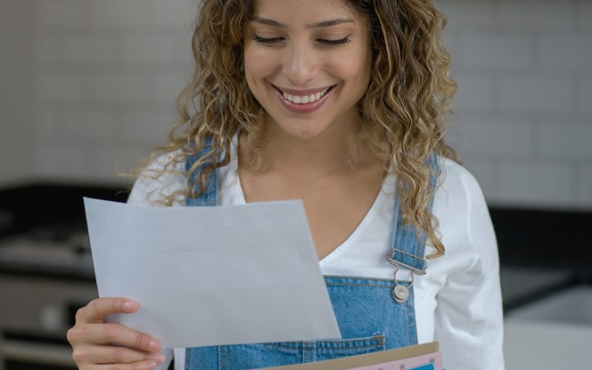 Happy Woman Reading Mail